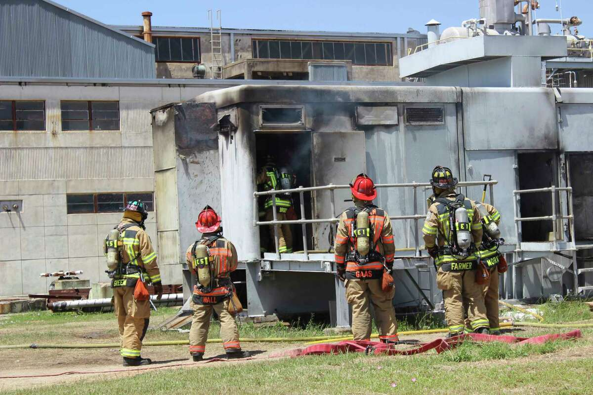 ADVANCE FOR WEDNESDAY, AUG 2, 2017 AND THEREAFTER - In this photo provide by the Bryan, Texas Fire Department, taken April 29, 2014, Bryan Texas firefighters stand outside the Bryan Texas Utilities Power Plant following an explosion and fire. Earle Robinson, 60, and other employees were doing maintenance work at Bryan Texas Utilities Power Plant, about 100 miles north of Houston, when there was a loud explosion. Workers called 911 and pleaded for help. Older people are dying on the job at a higher rate than workers overall, even as the rate of workplace fatalities decreases, according to an Associated Press analysis of federal statistics. (Bryan, Texas Fire Department via AP) ORG XMIT: WX503