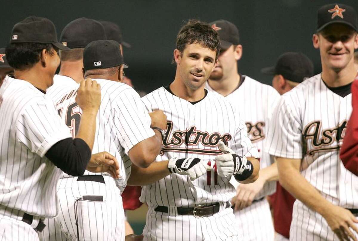 Houston Astros' Brad Ausmus (11) is congratulated by teammates after driving in the game-winning run in the bottom of the ninth inning against the New York Mets, Thursday, July 28, 2005, in Houston. The Astros beat the Mets, 3-2. (AP Photo/David J. Phillip)