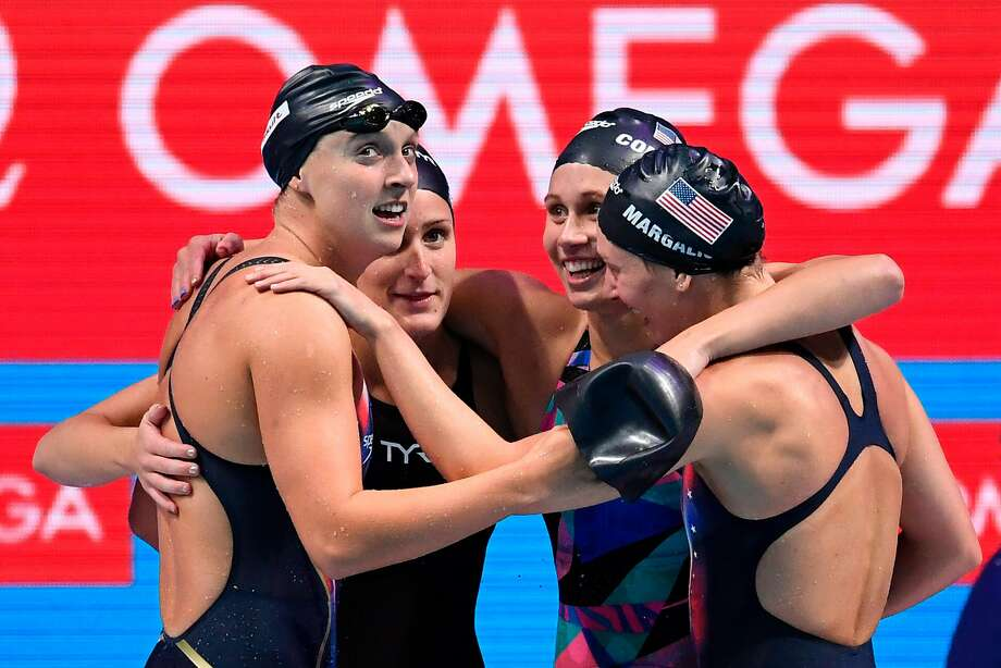 Stanford's Katie Ledecky (left), Leah Smith, Mallory Comerford and Melanie Margalis celebrate winning gold for the U.S. in the women's 4x200m freestyle relay at the world championships in Budapest. Photo: CHRISTOPHE SIMON, AFP/Getty Images