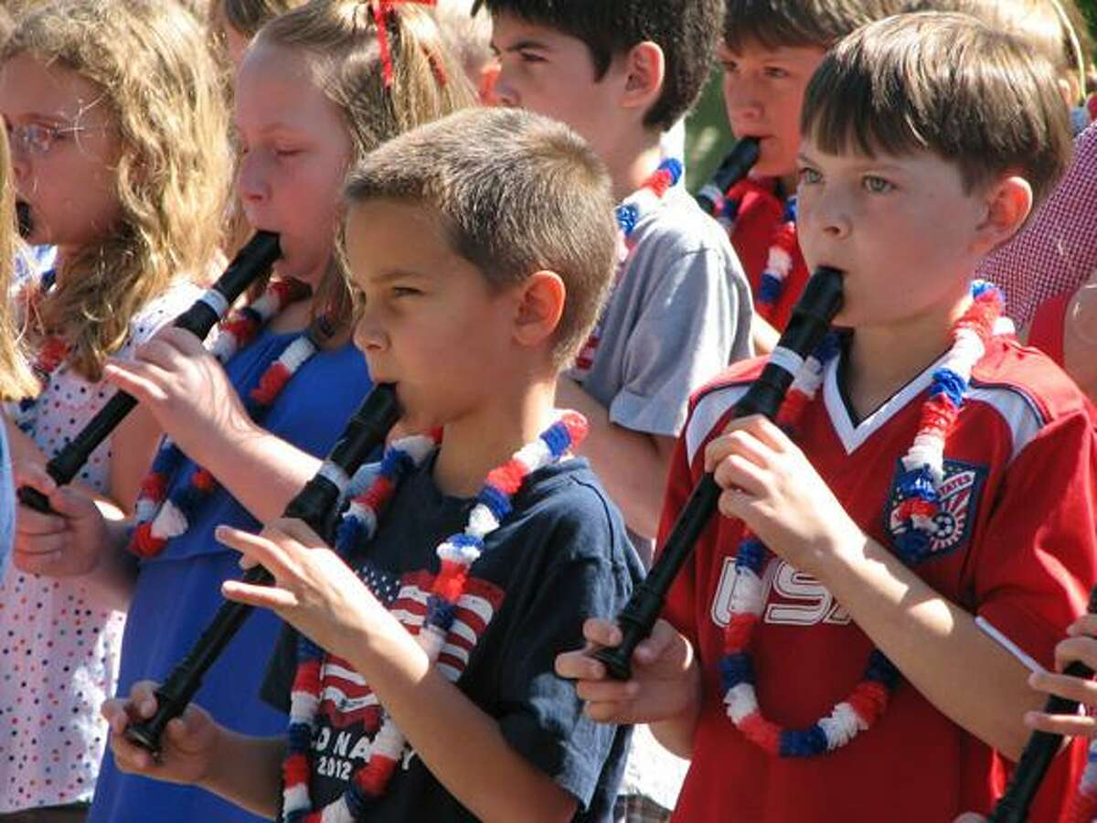 Center School third graders accompany the rest of the singing students on recorders during the Flag Day ceremony Thursday on the Litchfield green. (MICHELLE MERLIN / Register Citizen)