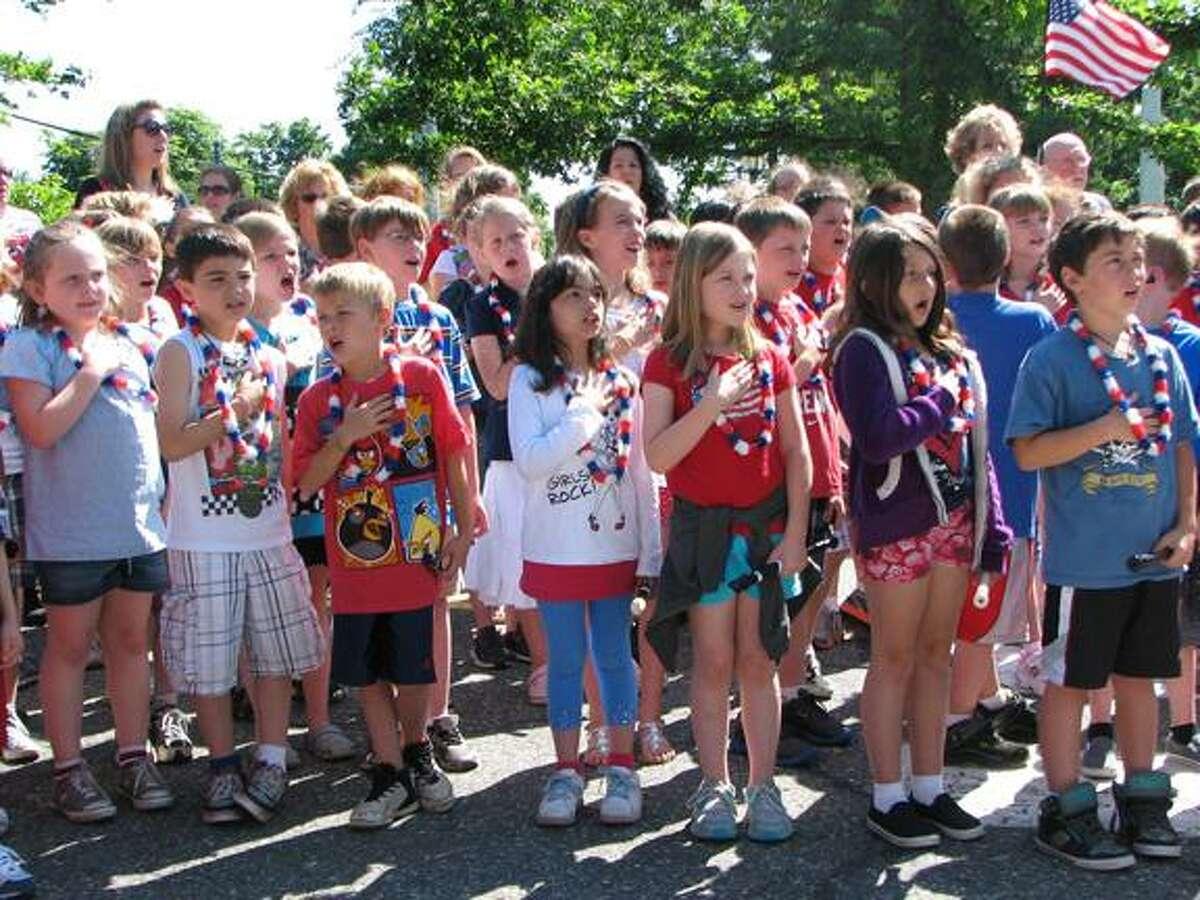 Center School students and teacher pledge allegiance to the flag on Flag Day. (MICHELLE MERLIN / Register Citizen)