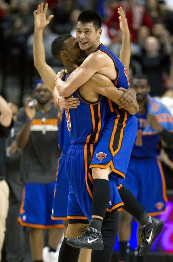 New York Knicks guard Jeremy Lin (17) celebrates with Jared Jeffries after his game-winning 3-pointer in an NBA basketball game the Toronto Raptors in Toronto on Tuesday, Feb. 14, 2012. The Knicks won 90-87. (AP Photo/The Canadian Press, Frank Gunn) Photo: AP / AP2012