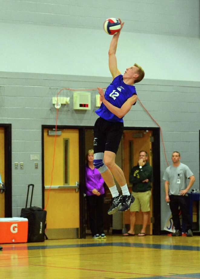Darien's Tim Herget serves the ball during FCIAC boys volleyball championship action against Ridgefield in Fairfield, Conn. on Friday May 26, 2017. Photo: Christian Abraham / Hearst Connecticut Media / Connecticut Post
