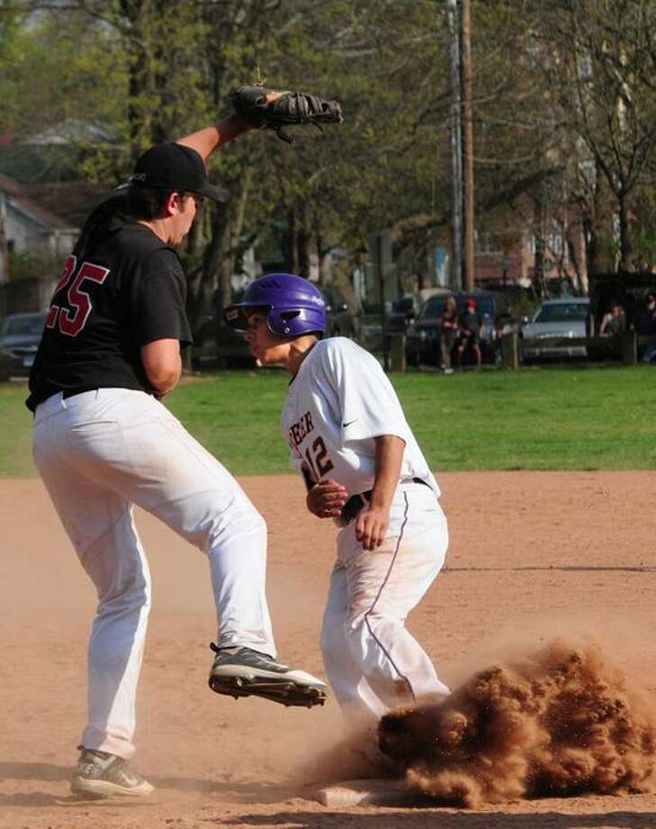 Career's Jose Negron makes it back to the bag after a caught fly ball. Branford first baseman is Brad Doyle. Branford beat Career 9-4. Melanie Stengel/Register