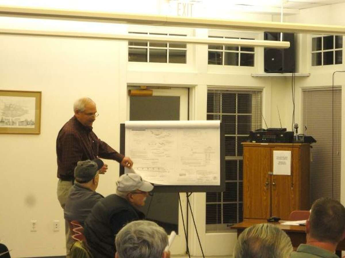 JASON SIEDZIK/ Register Citizen Jim Rotondo explains the proposed addition to Post Office Plaza at the Feb. 14 Harwinton Zoning Committee meeting. The committee did not decide the matter, pushing the decision off to their next meeting. To purchase a glossy photo of this picture, visit registercitizen.com.