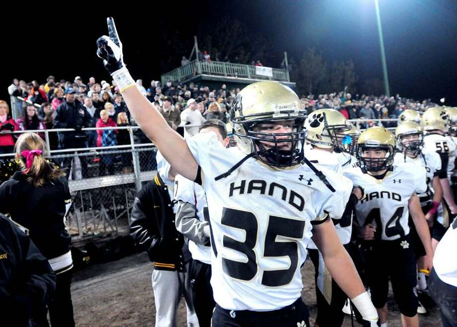 Alexander Tuccero (center) of Daniel Hand celebrates in the final minutes of the game against Xavier at Palmer Field in Middletown on 10/12/2012. Photo by Arnold Gold/New Haven Register