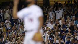 Fans cheer as Dodgers pitcher Kenley Jansen reacts after striking out Minnesota Twins Jorge Polanco (not pictured) during the ninth inning of in Los Angeles on July 26, 2017.