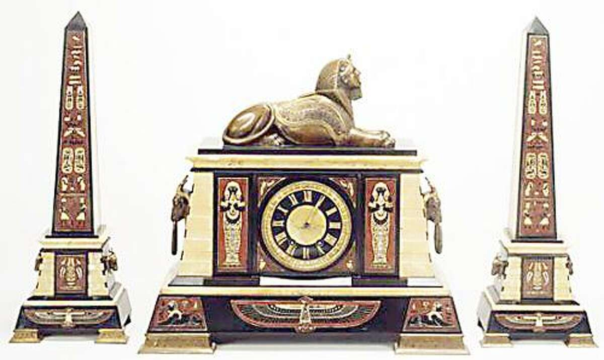 Collection of Munson-Williams-Proctor Arts Institute Museum of Art, Utica, New York. Mantle Garniture (clock and obelisks), ca. 1880, French, made for Tiffany & Co. (New York, New York), slate, marble, bronze, brass, wood, and glass.