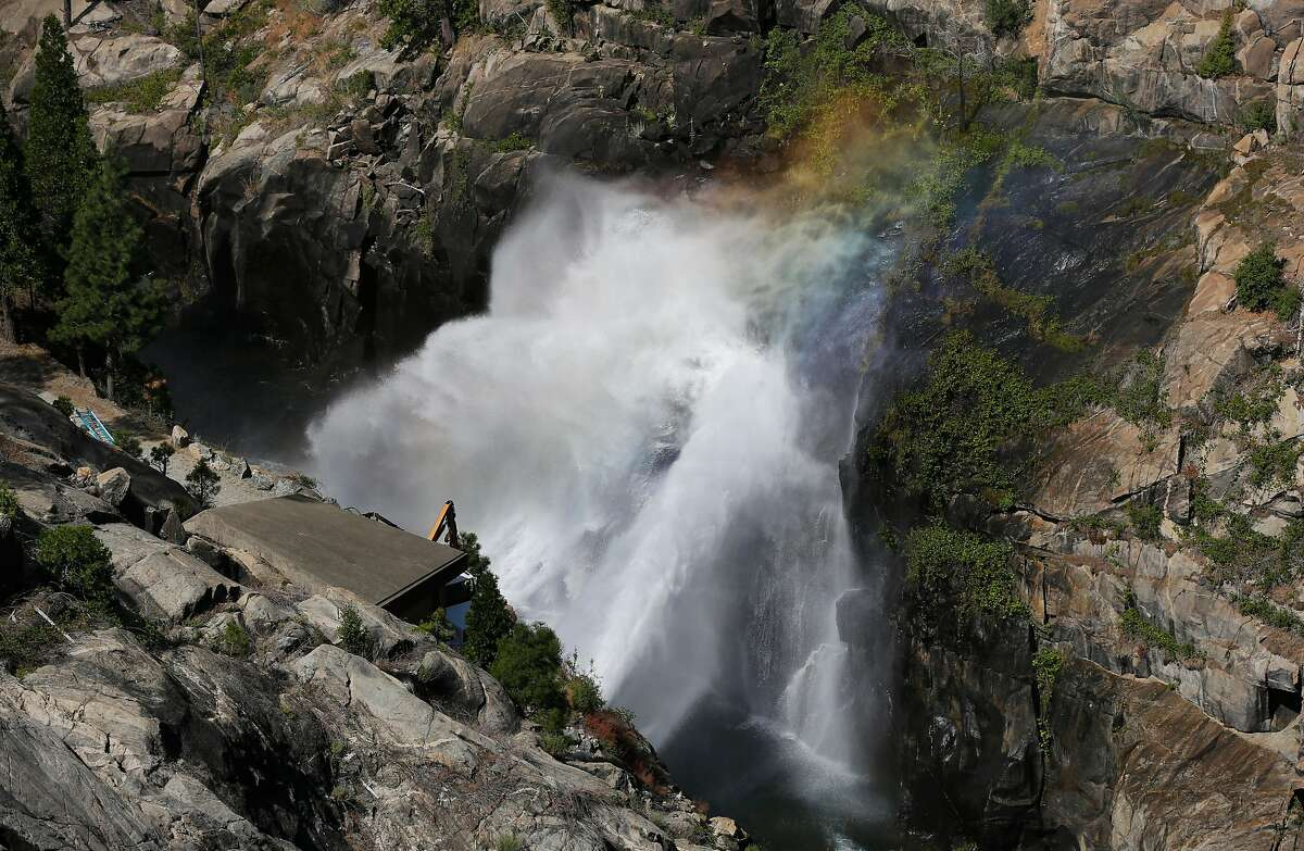 Water is released from O'Shaughnessy Dam July 7, 2015 at Hetch Hetchy Reservoir in Groveland, Calif.