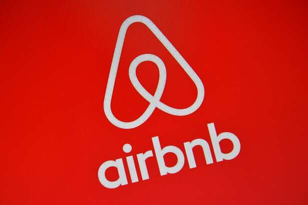 The Airbnb logo is displayed on a computer screen in London in 2016.