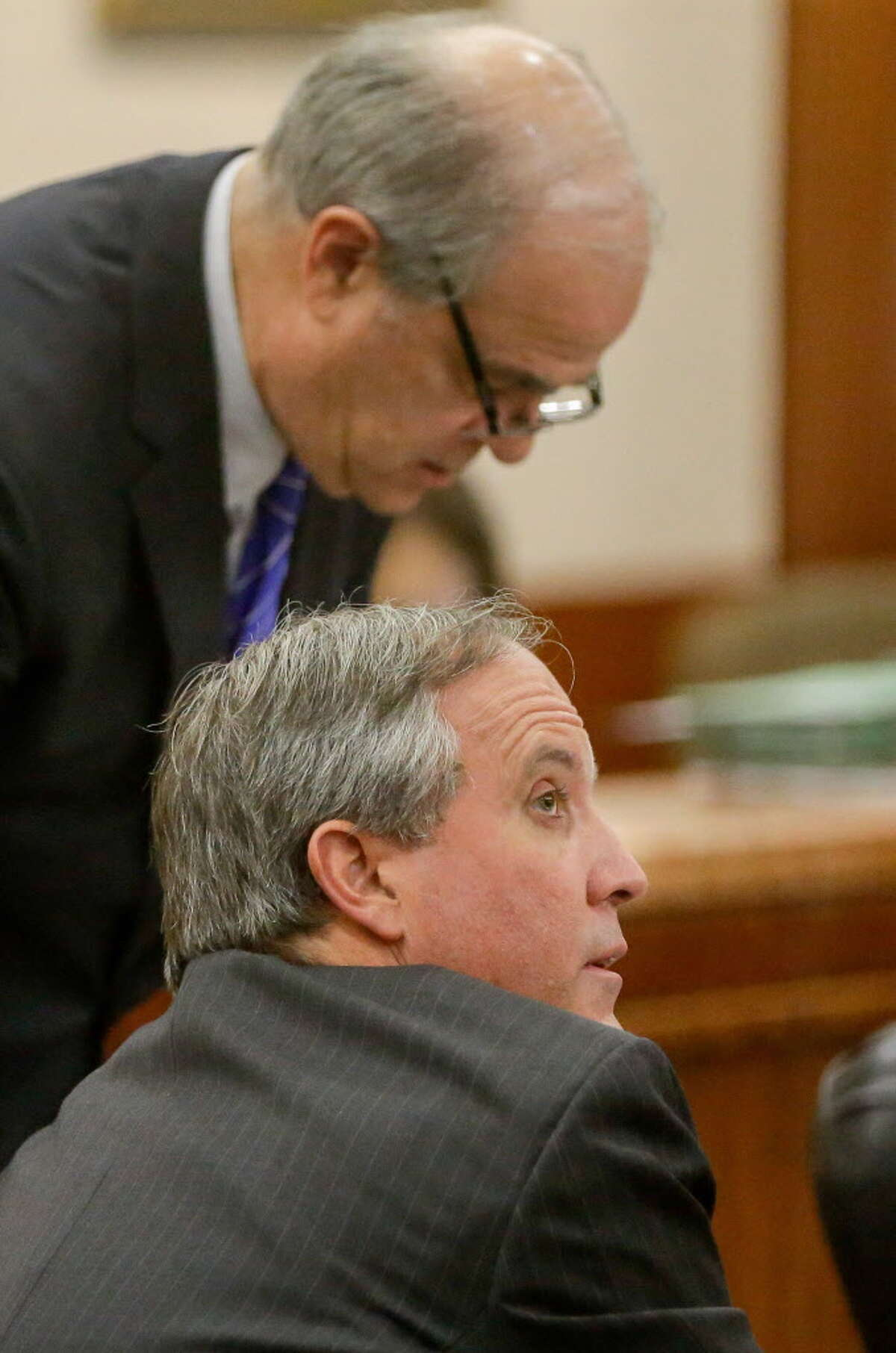 Texas Attorney General Ken Paxton, front, is shown with attorney Phil Hilder during a hearing in the Harris County Criminal 177th District Court of Judge Robert Johnson Thursday, July 27, 2017.