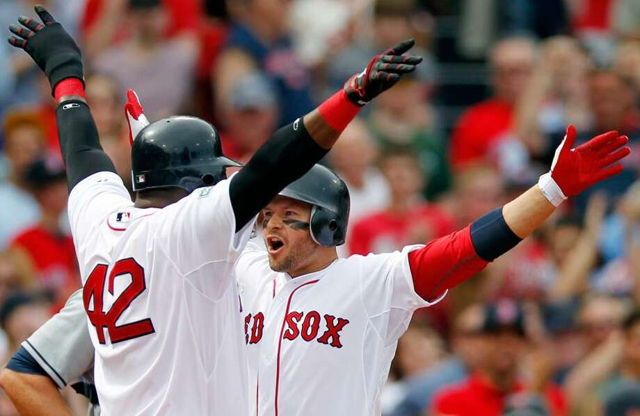 Boston Red Sox's Cody Ross, right, celebrates his three-run home run with teammate David Ortiz, left, in the second inning of a baseball game against the Tampa Bay Rays in Boston, Sunday, April 15, 2012. (AP Photo/Michael Dwyer) Photo: AP / AP2012