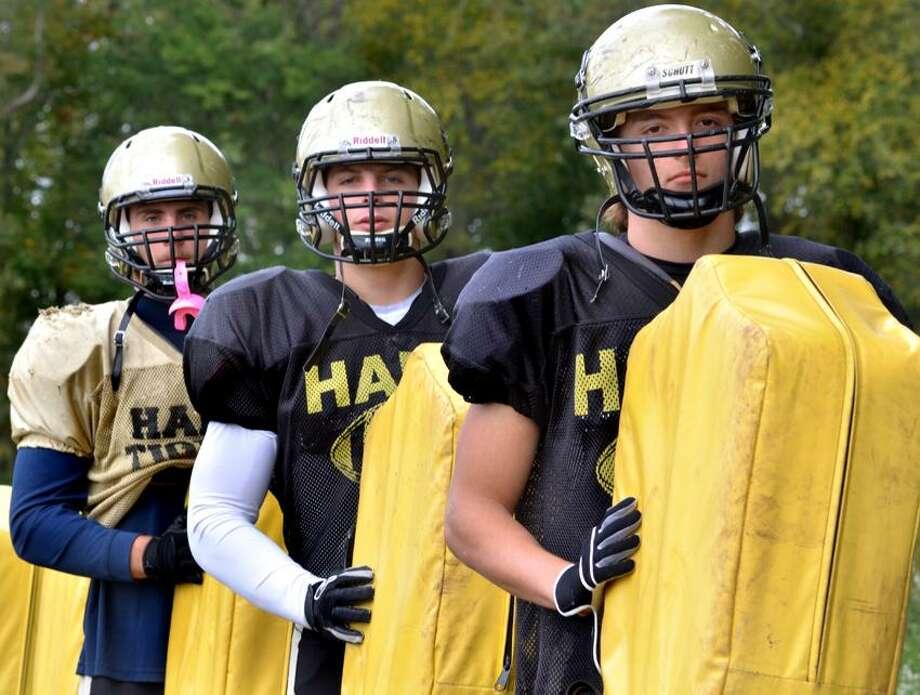 Hand football captains, from left, Peter Gerson, Matt Walsh and Alex Tuccero (Melanie Stengel/Register)
