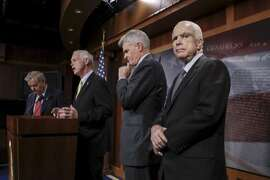 """From left, Sen. Lindsey Graham, R-S.C., Sen. Ron Johnson, R-Wis., Sen. Bill Cassidy, R-La., and Sen. John McCain, R-Ariz., speak to reporters at the Capitol as the Republican-controlled Senate unable to fulfill their political promise to repeal and replace """"Obamacare"""" because of opposition and wavering within the GOP ranks, in Washington, Thursday, July 27, 2017. (AP Photo/J. Scott Applewhite)"""