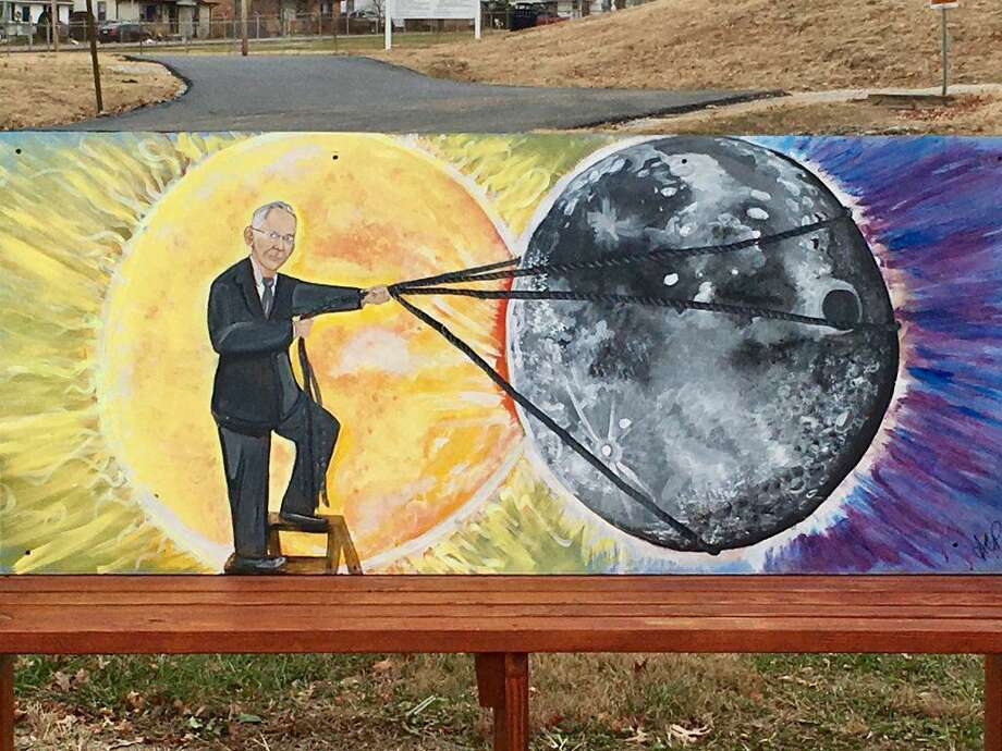 A bench outside the recreation department in Hopkinsville, Kentucky, depicts two town highlights: the coming solar eclipse, with Hopkinsville-born mystic Edgar Cayce lassoing the moon. Photo: Courtesy Terena Bell / The Washington Post