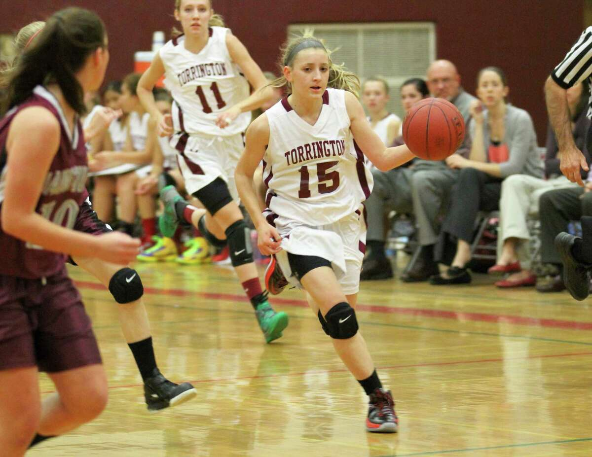 Torrington's Caroline Teti (#15) controls the ball during the Lady Raiders' game against Naugatuck Friday night at THS. Also pictured is teammate Nicole Kozlak (#11).