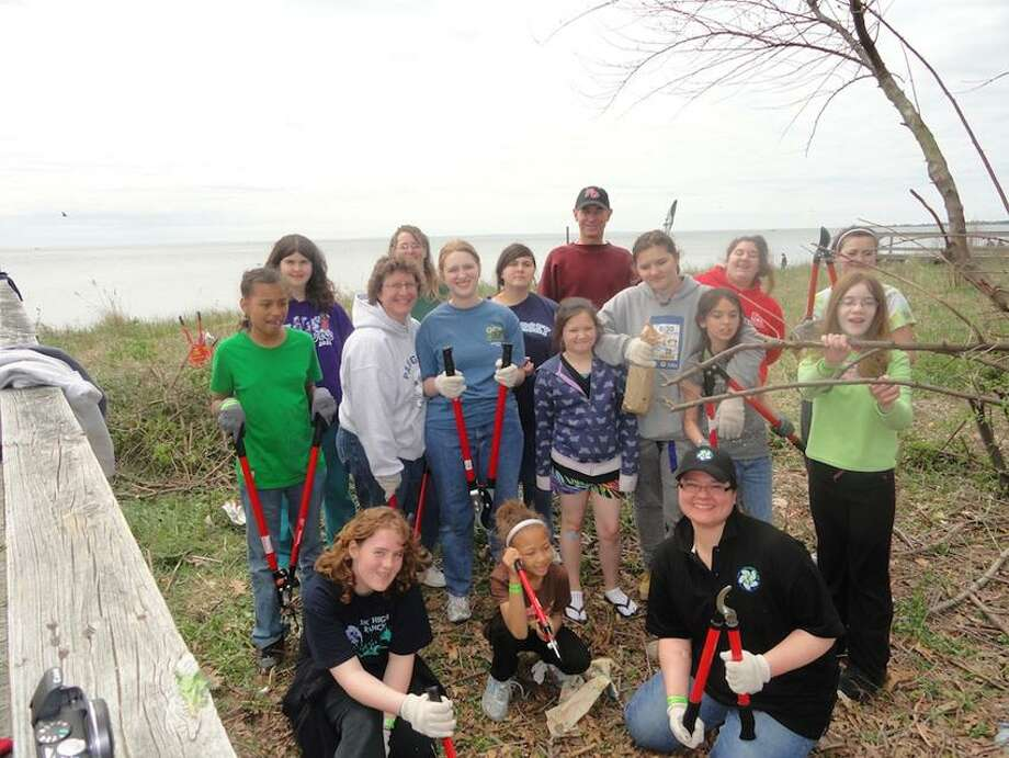 At last year's event, this happy group helped eradicate invasive plant species.