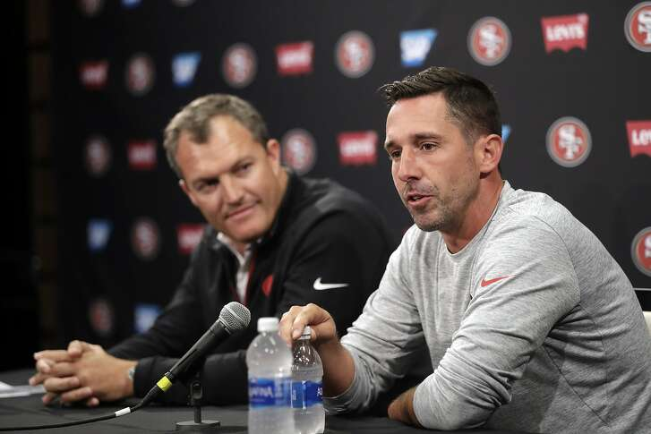 San Francisco 49ers head coach Kyle Shanahan, right, and general manager John Lynch field questions during the NFL team's football training camp Thursday, July 27, 2017, in Santa Clara, Calif. (AP Photo/Marcio Jose Sanchez)