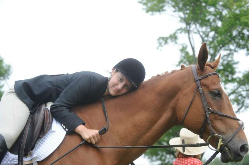Jennifer Rattray, 14, of Greenwich, with her horse at the 89th Annual Greenwich Horse Show, a major fundraiser for the Greenwich Riding & Trails Association on Sunday, June 13, 2010 on Pierson Drive.