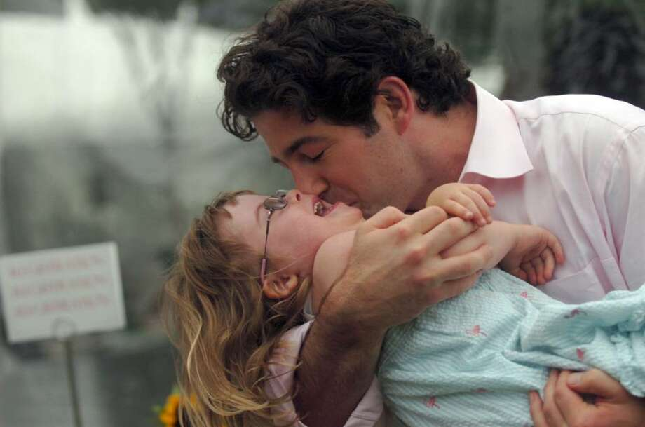 Frank Carpenteri kisses his niece Penny Becker,4, at the Abilis benefit on Sunday, June 13, 2010 at the Greenwich Polo Club at Conyers Farm. Photo: Helen Neafsey / Greenwich Time