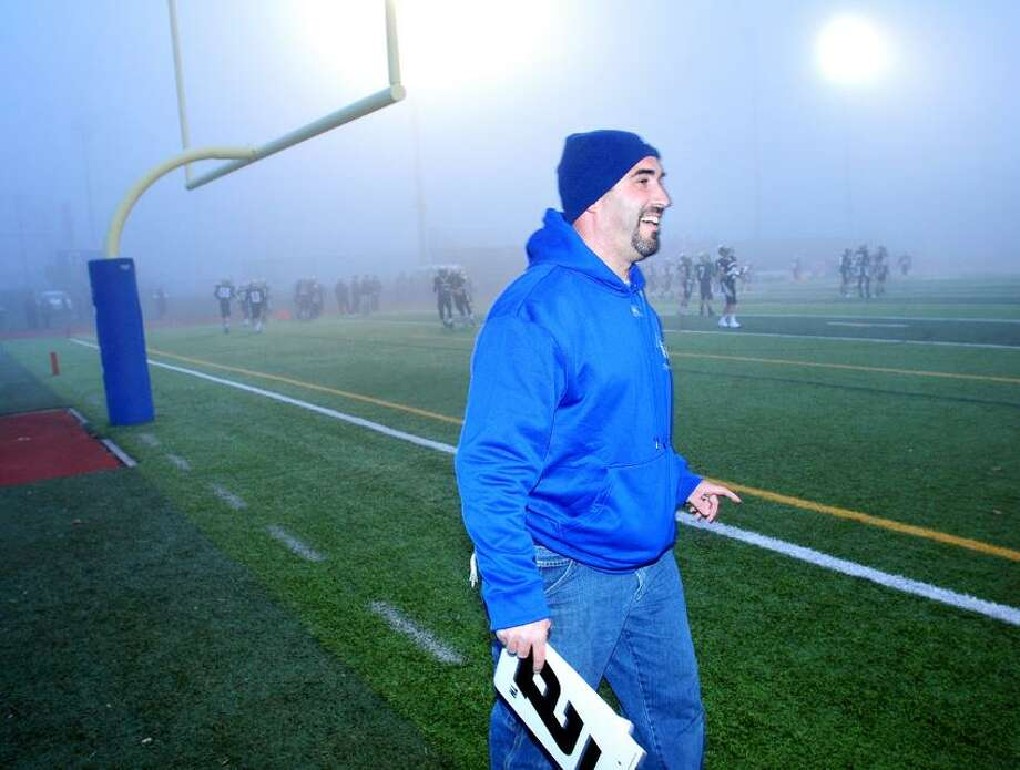 Chris Everone, West Haven High School facilities manager, attends to last minute details at Ken Strong Stadium before the Class L semifinal game between Daniel Hand and Masuk on 12/2/2012.Photo by Arnold Gold/New Haven Register
