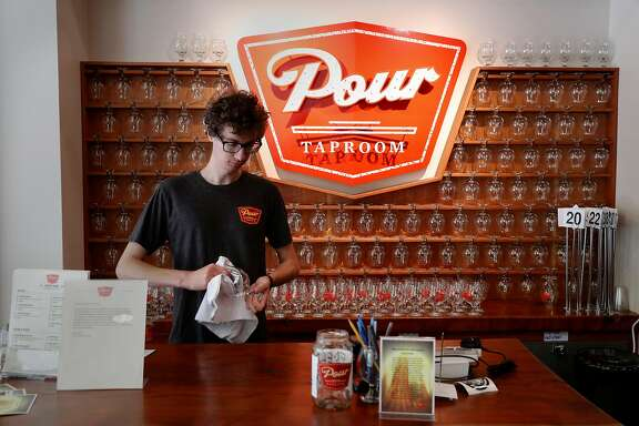 John Watson works the front desk and is also a server at Pour Taproom as seen on Thurs. July 27, 2017 in Santa Cruz, Ca.