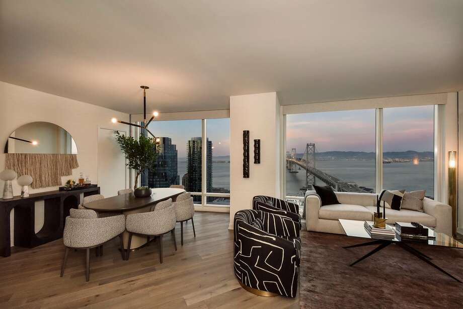 The living room offers unobstructed views of the Bay Bridge, and beautifully laid diagonal flooring. Photo: Visualhouse_Life