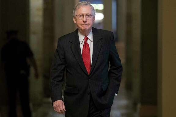 Senate Majority Leader Mitch McConnell of Kentucky walks from his office to the Senate floor on Capitol Hill in Washington on Wednesday. (AP Photo/Carolyn Kaster)