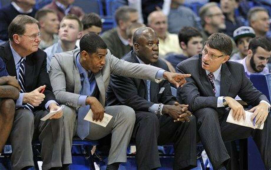 Connecticut coach Kevin Ollie, second from left, talks with his coaching staff during the second half of his team's 61-53 victory over New Hampshire in an NCAA college basketball game in Hartford, Conn., Thursday, Nov. 29, 2012. (AP Photo/Fred Beckham) Photo: AP / FR153656 AP