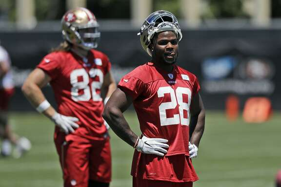 San Francisco 49ers running back Carlos Hyde (28) during NFL football practice at the team's training facility Wednesday, June 14, 2017, in Santa Clara, Calif. (AP Photo/Marcio Jose Sanchez)