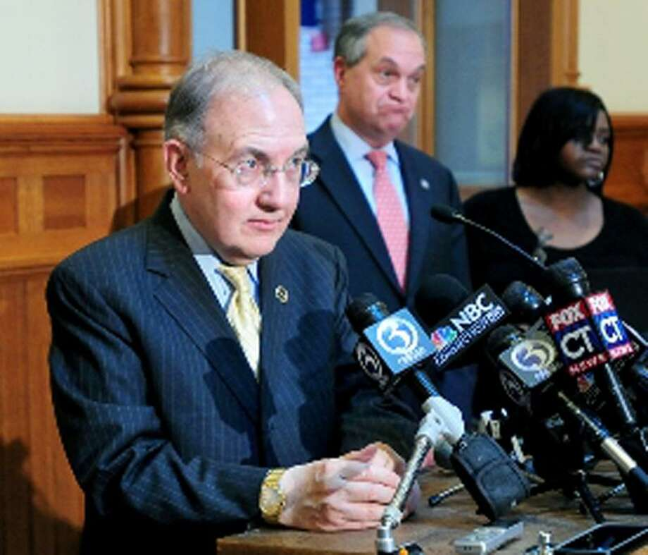 State Senate Majority Leader Martin Looney, left, answers questions concerning the repeal of the death penalty legislation at a press conference at City Hall in New Haven. At center is New Haven Mayor John DeStefano Jr. and at right is Victoria Coward whose son, Tyler, was shot and killed in 2007. Arnold Gold/New Haven Register