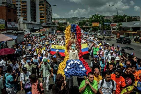 Priests, nuns and hundreds of other Catholics participated in May in a peaceful protest against government violence in Caracas, Venezuela. Nearly every day for more than three months, a ragtag group of protesters calling themselves El Resistencia have taken to the streets to vent fury at President Nicolé¡s Maduro's government. (Meridith Kohut/The New York Times)