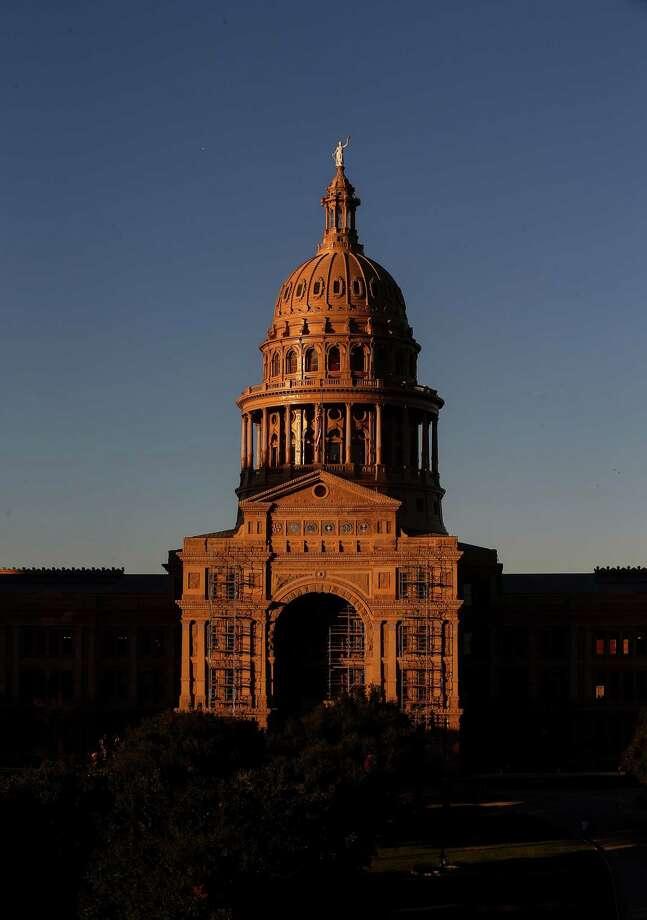 The sun sets over the Texas Capitol in Austin.  ( Jon Shapley / Houston Chronicle ) Photo: Jon Shapley, Staff / Internal