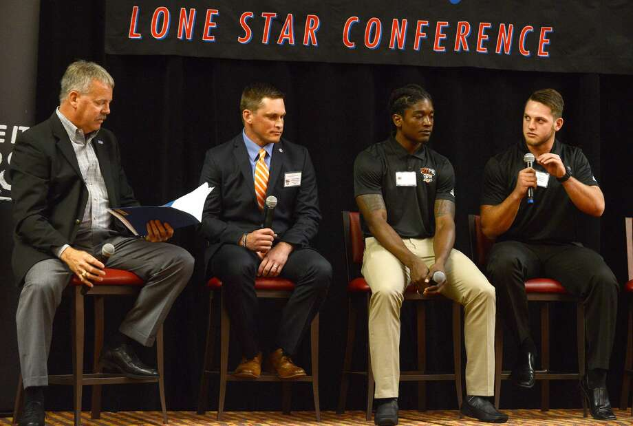 Chris Hoad, right, a sophomore linebacker on the University of Texas of the Permian Basin football team, answers a question from Kent Johnson, left, during the Lone Star Conference Media Day luncheon Thursday at the MCM Elegante Hotel. Also pictured are UTPB Head Coach Justin Carrigan and Falcon wide receiver Mitchell Leonard. Photo: Mark Sterkel|Odessa American