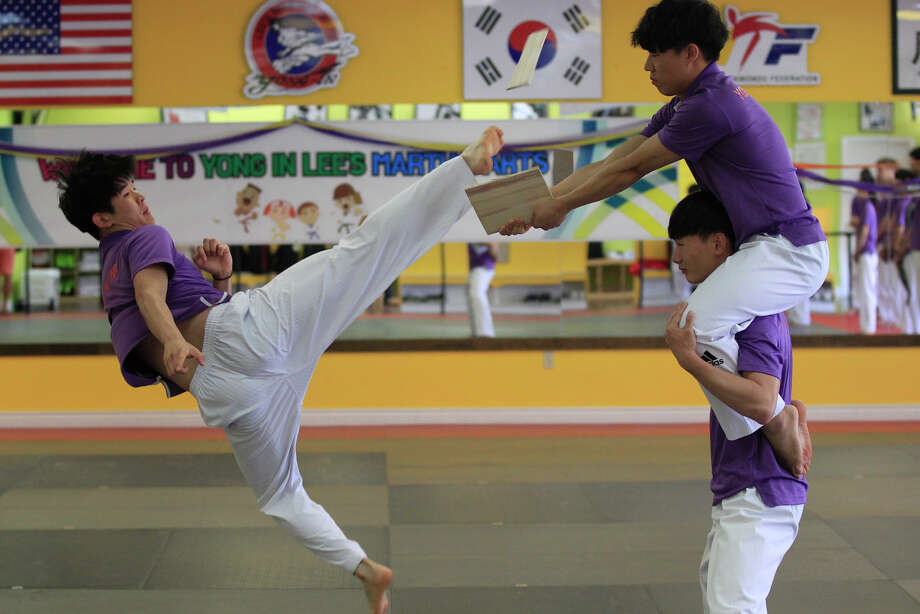 Members of the Korean Tae Kwon Do national team practice July 27, 2017, at Lee's Martial Arts School for an upcoming demonstration. James Durbin/Reporter-Telegram Photo: James Durbin