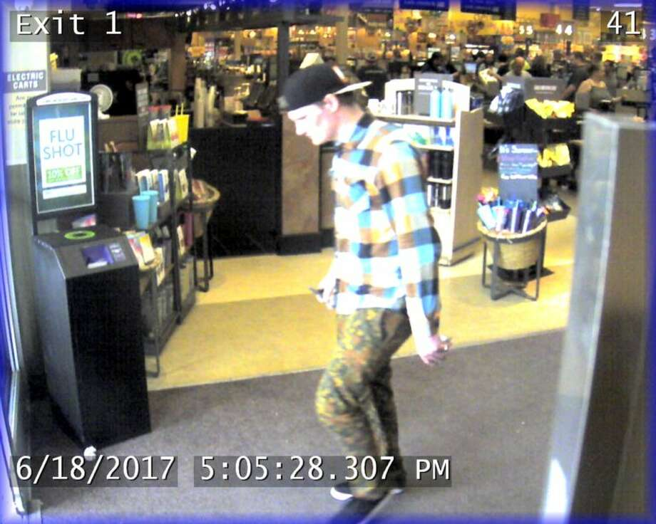 Seattle police hope to identify this man, pictured in a June 18 surveillance image. He is suspected of robbing an 89-year-old woman on a Ballard neighborhood street. Photo: Seattle Police Department