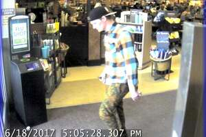 Seattle police hope to identify this man, pictured in a June 18 surveillance image. He is suspected of robbing an 89-year-old woman on a Ballard neighborhood street.