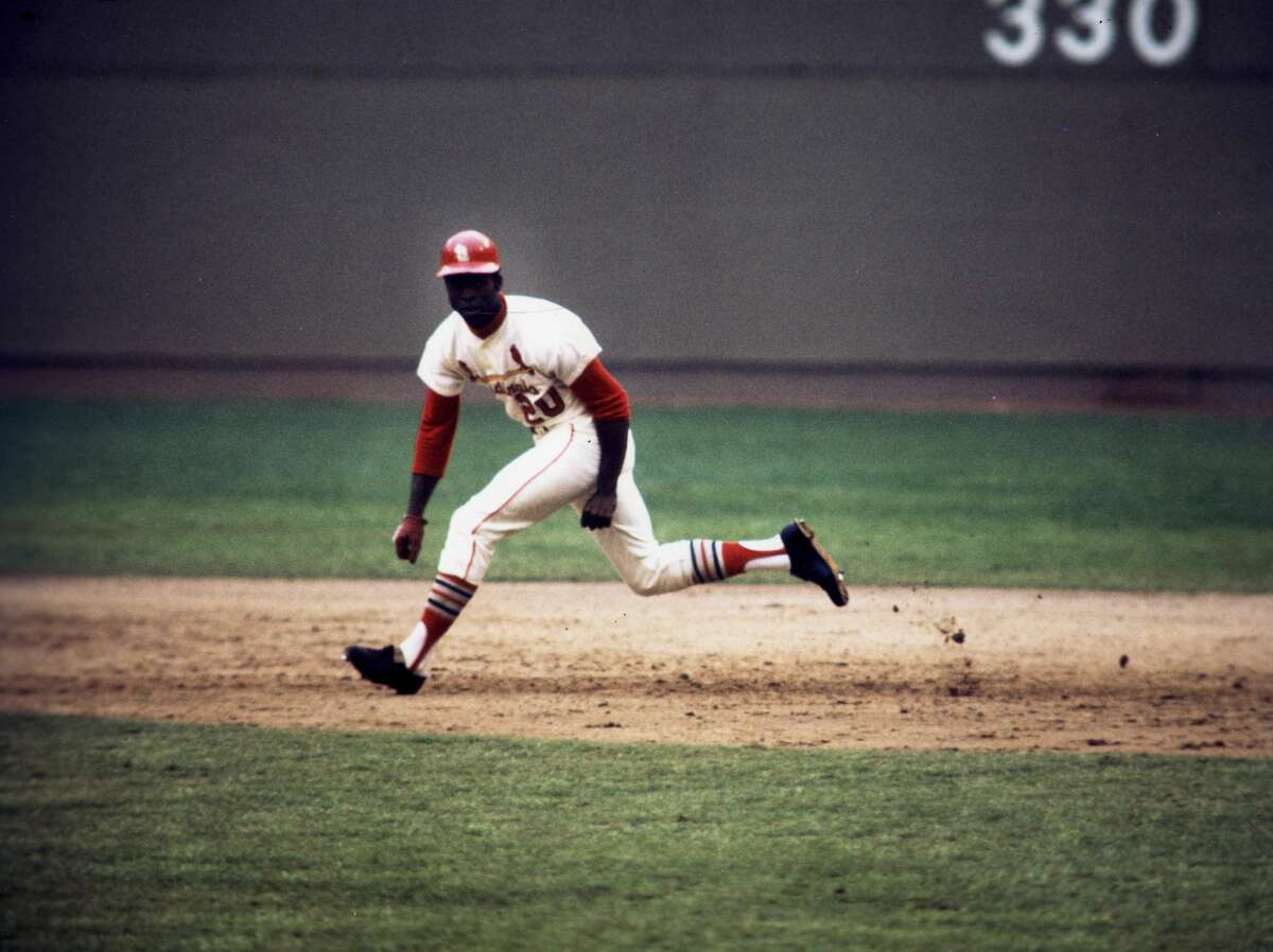 ST. LOUIS, MO - CIRCA 1973: Lou Brock stealing another base during a game at Busch Stadium circa 1973 in St. Louis, Missouri. (Photo Reproduction by Transcendental Graphics/Getty Images)