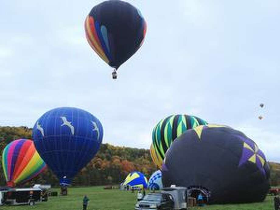 """Dispatch Staff Photo by JOHN HAEGER <a href=""""http://twitter.com/oneidaphoto"""">twitter.com/oneidaphoto</a>Balloons begin to fill the sky as they launch  from Wolf Oak Acres during the annual Balloons and Bounty  on  Sunday , Oct. 7, 2012 in Oneida."""
