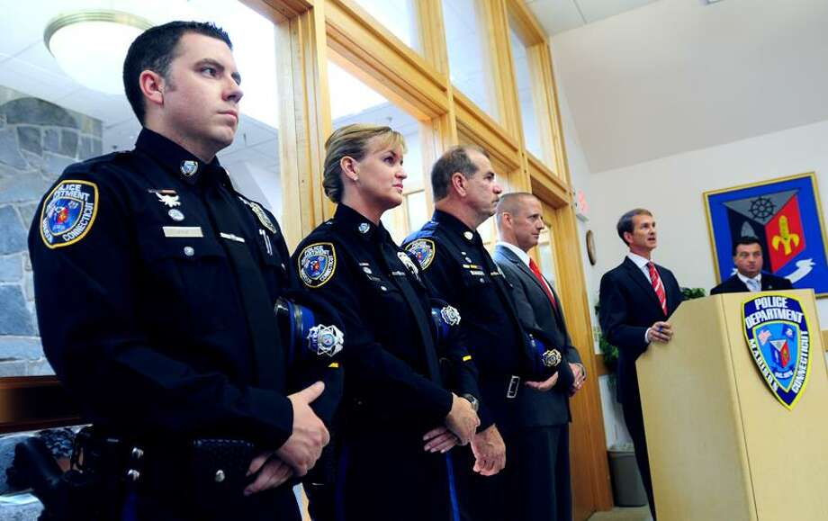 Left to right, Sgt. William Roy, Sgt. Kimberly Lauria, Sgt. Richard Perron and Commander John Rich wait to be sworn in at the Madison Town Offices. Photo by Arnold Gold/New Haven Register