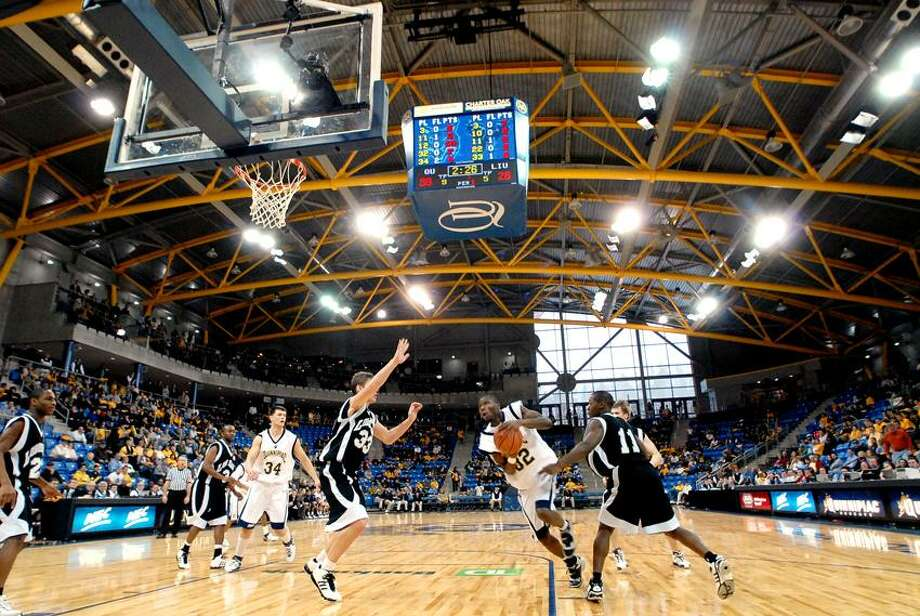 HAMDEN-NEW ARENA-PHOTO/JEFF HOLT-JH00183A1/27/07-Quinnipiac's Chris Wehye drives to the basket in 1st half action during  the  opening day game at Quinnipiac's TD Banknorth Sports Center. (Photo/Jeff Holt)