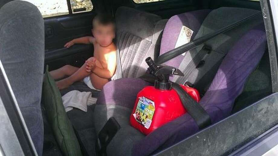 This photo was taken during a traffic stop when police realized a woman had strapped a gas can into her child's car seat. Photo credit: Colorado Department of Transportation