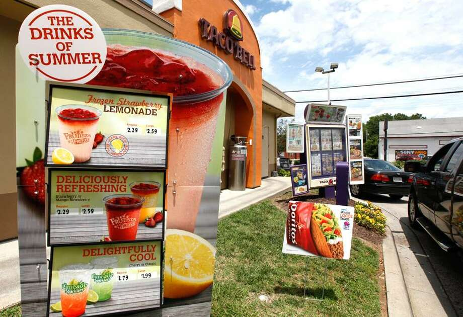 Drivers use the drive-thru lane at a Taco Bell restaurant  in Richmond, Va., Wednesday.  The chain said it plans an early July rollout of a menu addition created by celebrity chef Lorena Garcia for its nearly 5,600 U.S. restaurants. Associated Press Photo: AP / AP