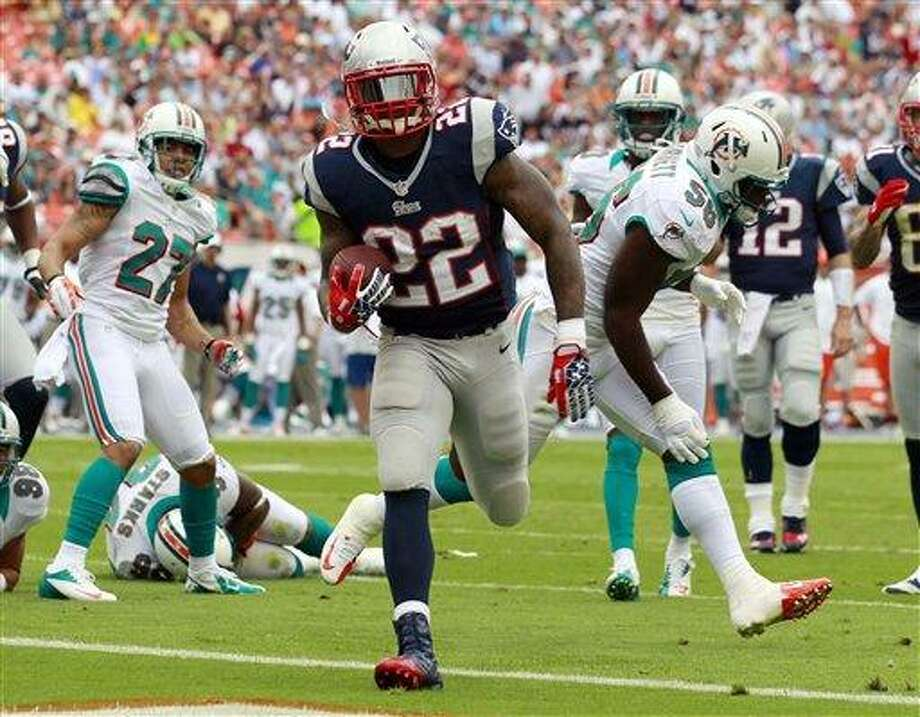 New England Patriots running back Stevan Ridley (22) scores a touchdown during the first half of an NFL football game against the Miami Dolphins, Sunday, Dec. 2, 2012 in Miami . (AP Photo/John Bazemore) Photo: AP / AP