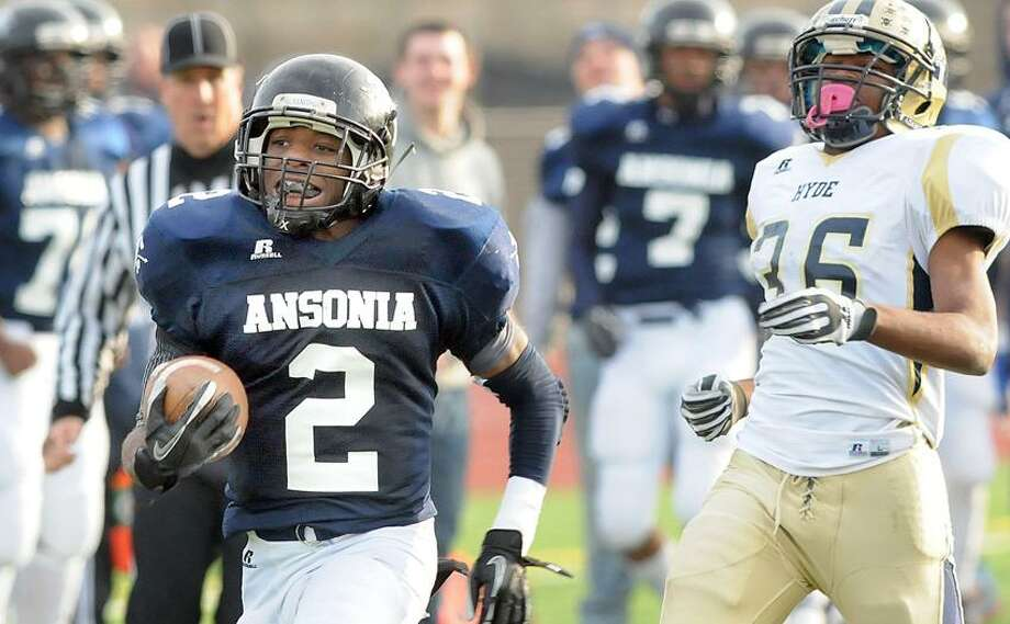 Middletown: Class S football semifinals between Ansonia and Hyde. It was Arkeel Newsome's day.  Mara Lavitt/New Haven Register