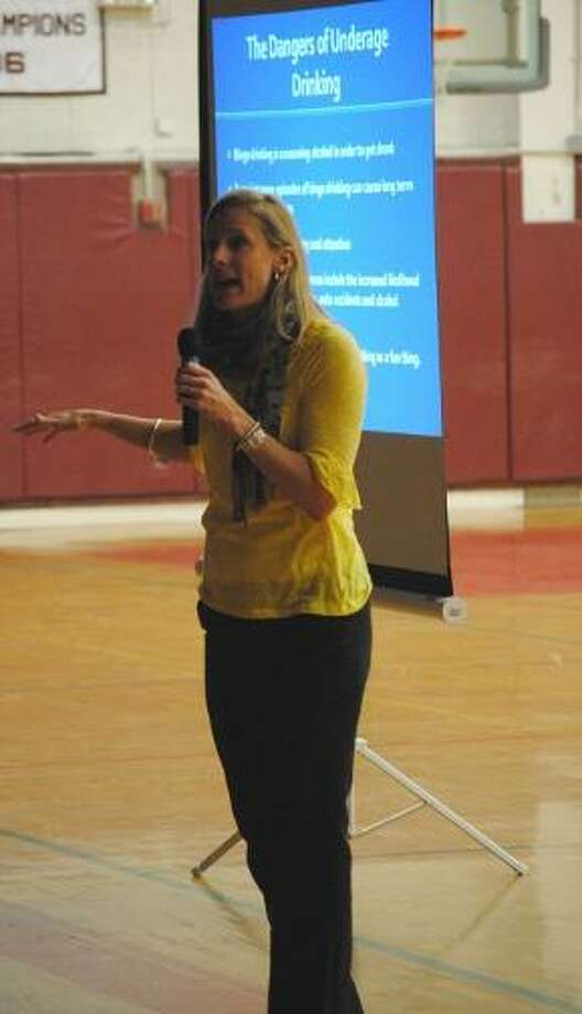 MIKE AGOGLIATI/ Register Citizen  Maria Skinner of the McCall Foundation spoke to students at Torrington High School Tuesday about the dangers of underage drinking.