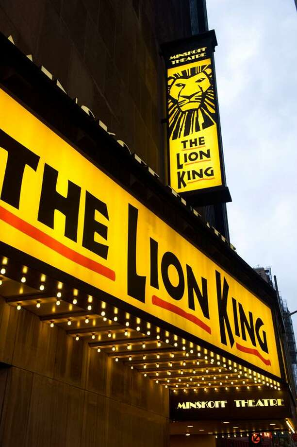 """FILE - In this Jan. 19, 2012 file photo, the Minskoff Theatre and the marquee for """"The Lion King"""" are seen in New York. Box office revenues show that """"The Lion King"""" has recently swiped the title of Broadway's all-time highest grossing show from """"The Phantom of the Opera."""" (AP Photo/Charles Sykes, File) Photo: AP / AP2012"""