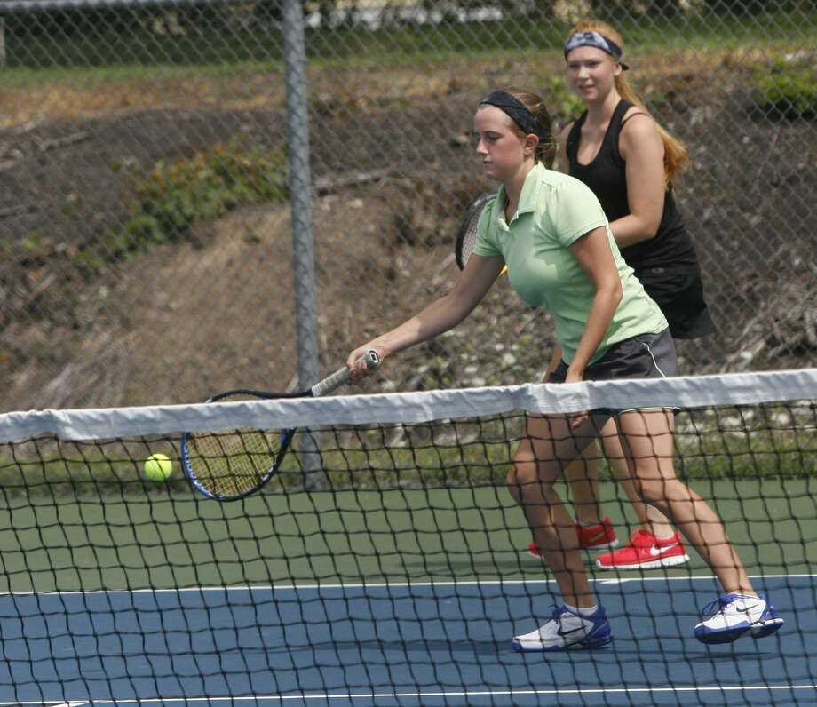 """Dispatch Staff Photo by JOHN HAEGER <a href=""""http://twitter.com/oneidaphoto"""">twitter.com/oneidaphoto</a> Connie Froass returns a shot as teammate Hannah Barley backs up the play during their doubles match in the semifinals of the City of Oneida tourney on Sunday, August 5, 2012."""