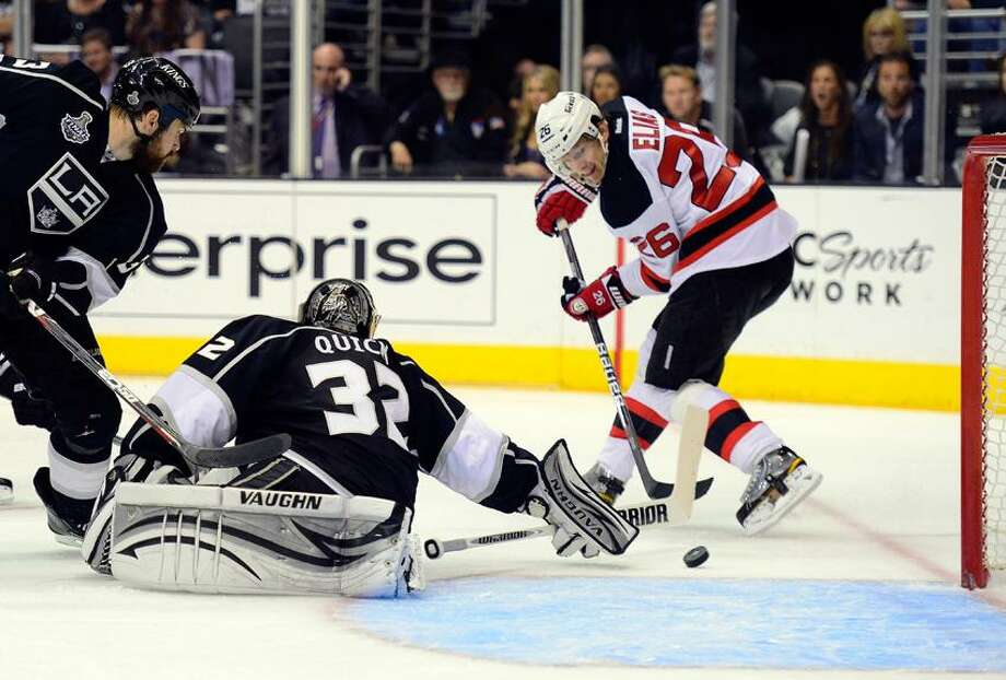 New Jersey Devils Patrik Elias (26), of Czech Republic, shoots the puck past Los Angeles Kings goalie Jonathan Quick (32) for a goal in the third period during Game 4 of the NHL hockey Stanley Cup finals, Wednesday, June 6, 2012, in Los Angeles.  (AP Photo/Mark J. Terrill) Photo: AP / AP2012