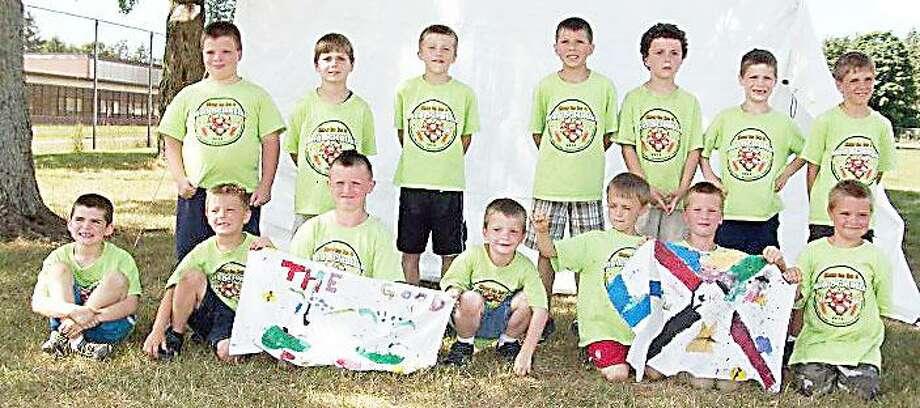 Photo Courtesy CUB SCOUTS Cub Scouts participate in a summer day camp.